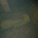 Topedo lying on the deck in the forward torpedo room